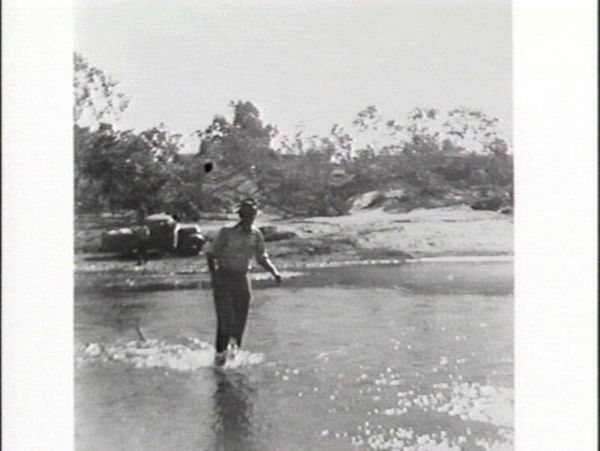 Man walking in a river
