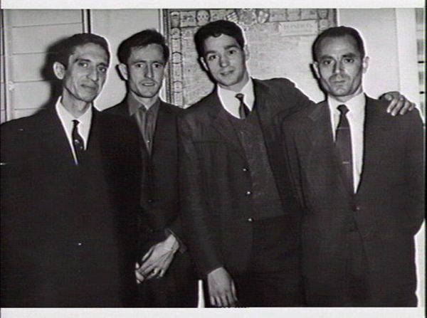 Four men at a function