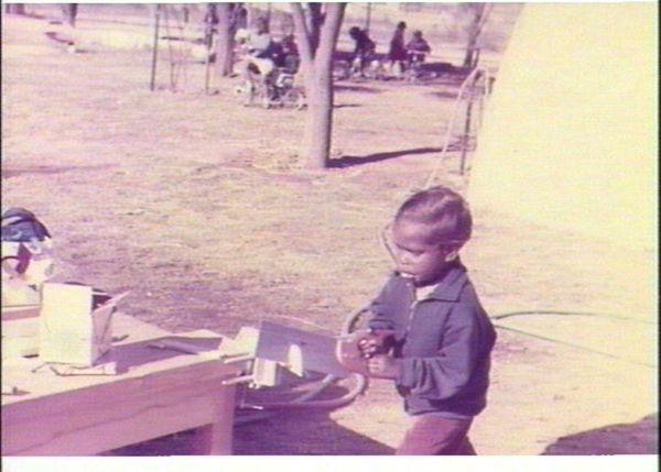Aboriginal boy at wood play