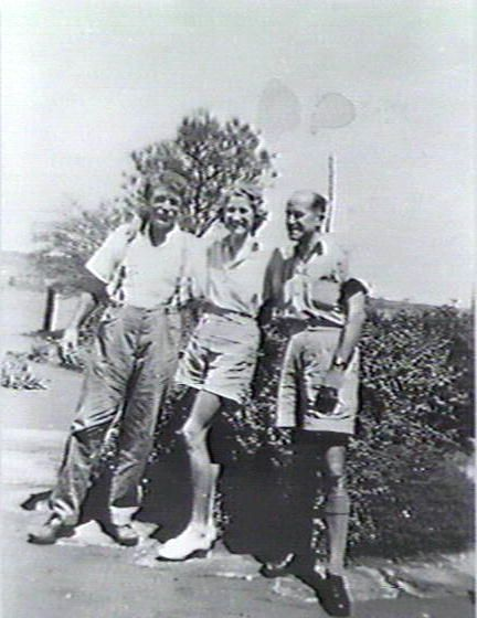 Woman posing with two men