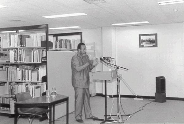 Commodore Eric Johnston conducting a speech at the Northern Territory State Reference Library