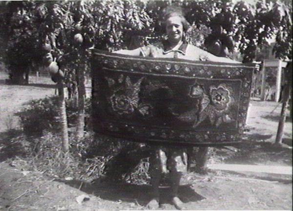 Mrs Turner holding rug