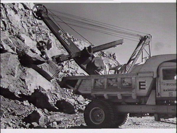 Ore being loaded onto a dump truck