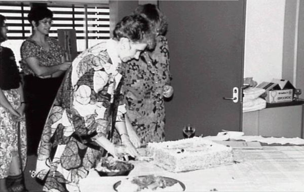 Sheila Forrest and staff cutting a celebration cake for the Northern Territory State Reference Library