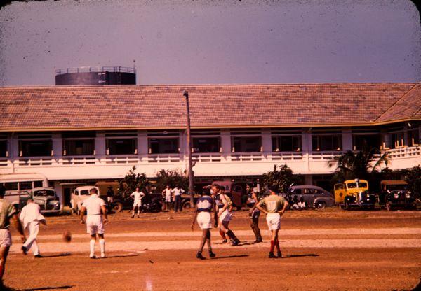 Playing football on the Esplanade, Darwin Hotel