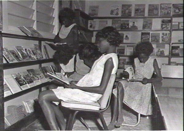 Aboriginal school girls reading in library