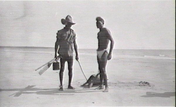 Aboriginal man with a turtle