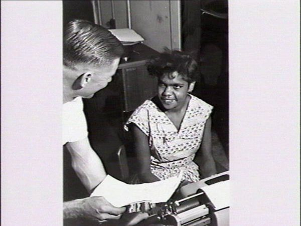 Woman being handed document for typing